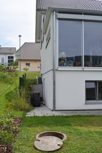 German house and cistern in garden