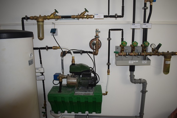 Pump and pipework for recycling rainwater